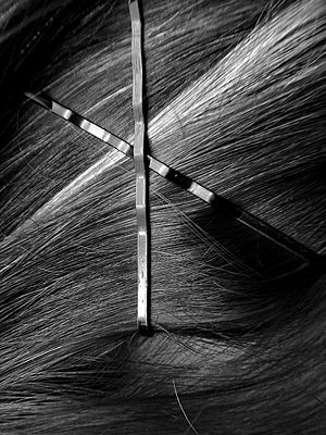 Curl bangs or sections of hair and hold them up elaborately with bobby pins.