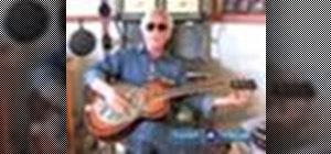 Play Dobro slide guitar