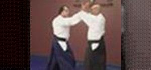 Use the Aikido Yokomenuchi Waza technique