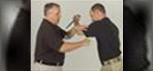 Defend against an overhead attack with an edged weapon