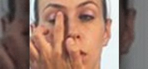 Create a pink eyeshadow and black eyeliner makeup look