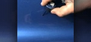 Touch up the paint on a car and fill in any missing spots