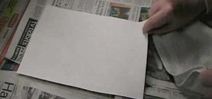 Use ninhydrin to reveal latent prints on paper