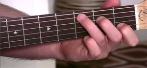 Play easy slash chords on an acoustic guitar