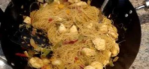 Make Singapore noodles with chicken and shrimp