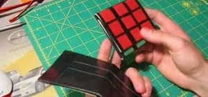 Make a Rubik's Cube wallet out of colored duct tape