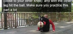 Do a crossover freestyle soccer trick sitting down
