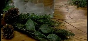 Create an affordable Christmas centerpiece with evergreen sprigs