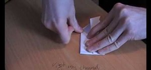 Make a folded origami frog that jumps