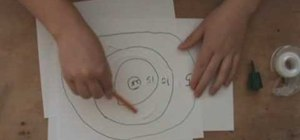 Make a sticky target with glue for shooting paper guns