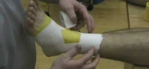 Tape an ankle to prevent an injury in basketball