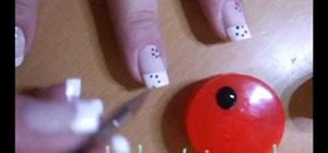 Paint little dotted flowers on your nails