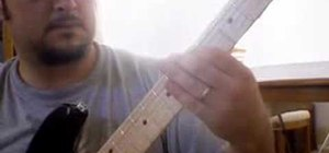"Play ""Jailbreak"" by AC/DC on electric guitar"