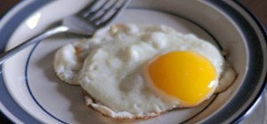 Fry an egg with a runny yolk