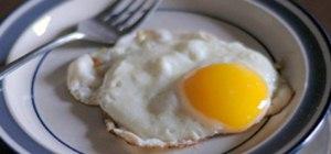 Fry an egg with a runny yolk