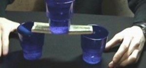 Balance a full glass on a dollar bill