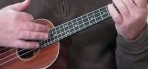 Play a G7 shuffle strum pattern on the ukulele