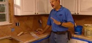 Install kitchen tile and apply grout