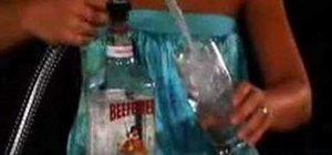 Mix a Beefeater gin and tonic cocktail
