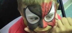 Apply Spiderman face mask using powder