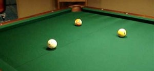 Aim for a cut trick shot in a game of pool