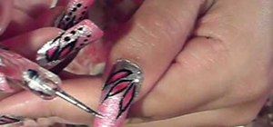 Paint your nails with a pink and silver glitter design