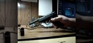 Field strip a post-war production Walther P38 pistol