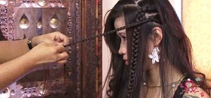 Create a sweet and sassy Pocahontas hairstyle with braids