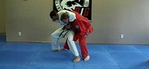 Escape a head lock using the Jiu Jitsu sit and roll