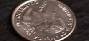 Perform a vanishing coin trick with a glass and a coin