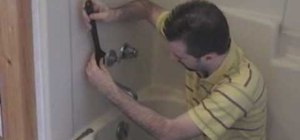 Replace the washer in your shower faucet to stop a leak