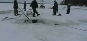 Recover a snowmobile sled from shallow water under ice