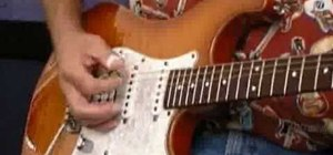 Play power chords on electric guitar