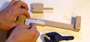 Make a Jenga block pistol that shoots