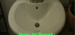 Rig a bathroom prank by running the toilet water tube to the sink