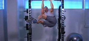 Do real hanging alternate twisting knee tucks