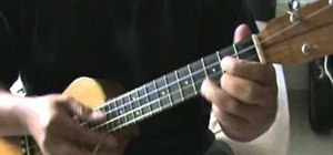 "Play ""Redemption Song"" by Bob Marley on the ukulele"