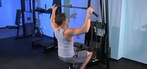 Work the lateral muscles with wide grip lat pull downs