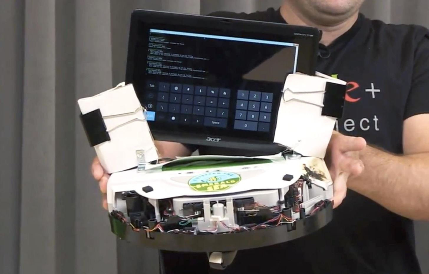 Old Roomba Vac Modified into a Robot Controlled by Google+ Hangout Users
