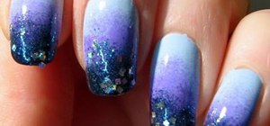 Create a starry blue sky nail look