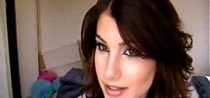 Style a Kim Kardashian middle part hairstyle
