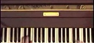 "Play ""Carry That Weight"" by the Beatles on piano"