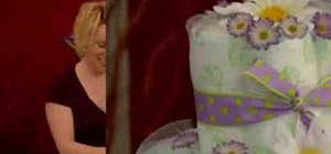 Make a diaper cake for a baby shower centerpiece