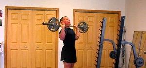 Do a standing barbell shoulder press to build massive deltoids