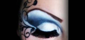 Apply a black, blue & white floral makeup look