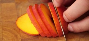 Slice a ripe peach with a forward cut
