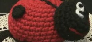 Crochet a small ladybug out of red and black yarn