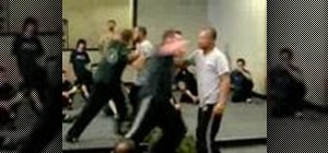 Do a Krav Maga gun from behind explosive defense