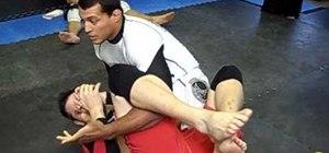 Break down an opponent for the flower sweep in jiu jitsu
