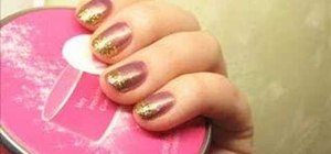 Apply a mauve and gold French manicure